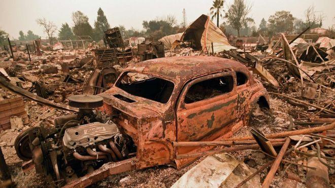 Carr wildfire damage image via BBC and AP